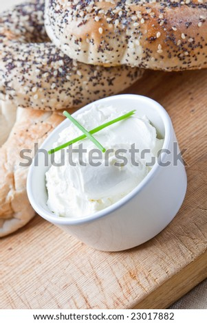 A pile of 4 mixed bagels with cream cheese - stock photo