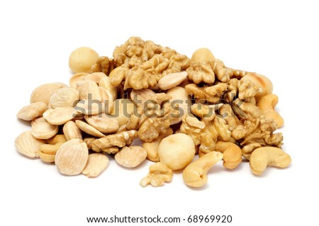 a pile of mixed peeled nuts on a white background