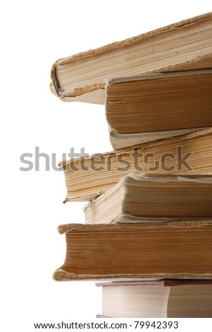 A pile of old books, isolated on white