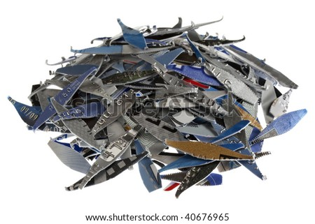 a pile of old expired credit card shredded, isolated on white - protection against identity theft concept