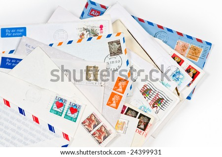 A pile of old letters with stamps