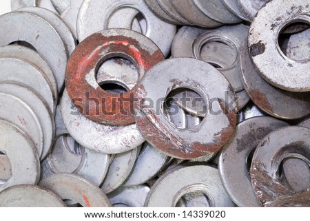 A pile of old metal washers for use in a machine shop.