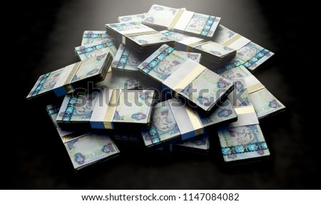 A pile of randomly scattered bundles of Dirham banknotes on an isolated background - 3D render