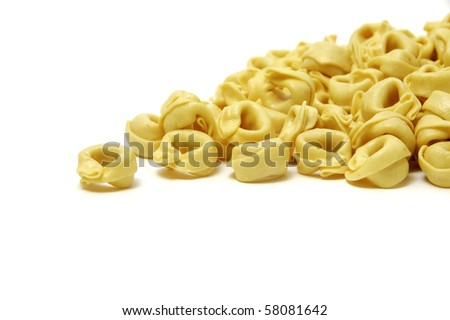 a pile of raw tortellini isolated on a white background