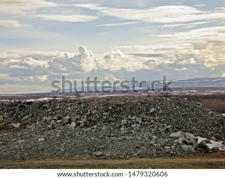 a pile of rubble on the ground. Crushed stone in the tundra