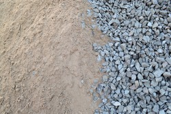 A pile of sand and gravel on a construction site.Concept - building materials, repair, construction, road embankment, road construction.