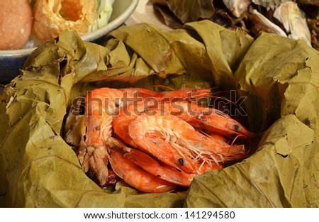 A pile of steamed shrimps on lotus leaf