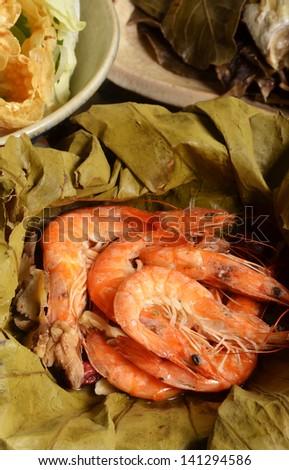 A pile of steamed shrimps on lotus leaf