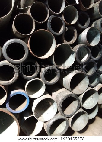 A pile of steel pipes in a steel factory