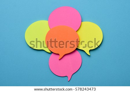 a pile of sticky notes sticky notes in the shape of speech balloons of different colors with a blank space, on a blue background #578243473
