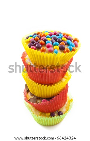 A pile of sweet cup cakes isolated over white