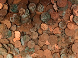 A pile of tarnished and partially corroded British copper coins - one and two pence pieces