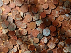 A pile of tarnished and partially corroded British copper coins - one and two pence pieces - and a lot of verdigris