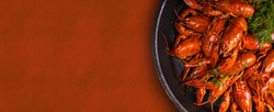 A pile of tasty boiled crawfish. Boiled red crayfish or crawfish with  herbs. Crayfish party, restaurant, cafe, pub menu.