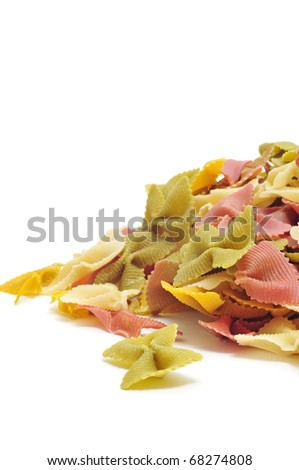a pile of uncooked vegetables farfalle isolated on a white background