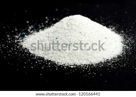 a pile of washing powder on black