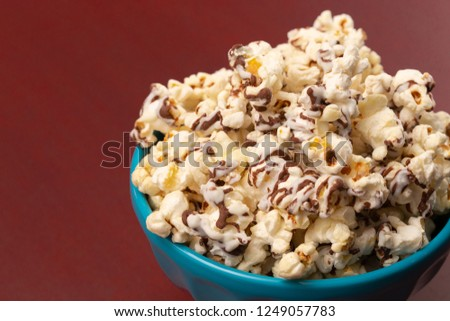 A Pile of White and Milk Chocolate Drizzled Sweet Popcorn