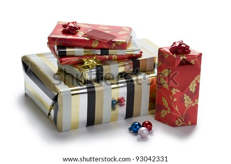 a pile of wrapped Christmas or Xmas gifts or presents isolated on a white background