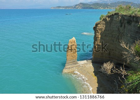 A pillar the sea and the wind created from the clay Canal d'Amour, Sidari Village, Corfu Island, Greece, Europe Canal d'Amour (love channel) is a great nature's masterpiece carved by sea and wind.