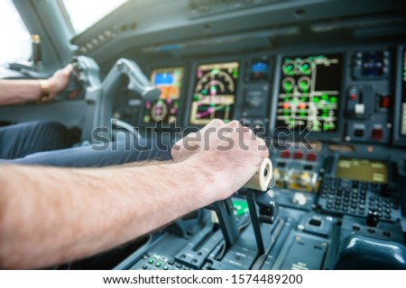 A Pilot hands controlling airplane