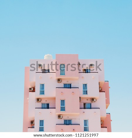 A pink beachfront building in Larnaca, Cyprus