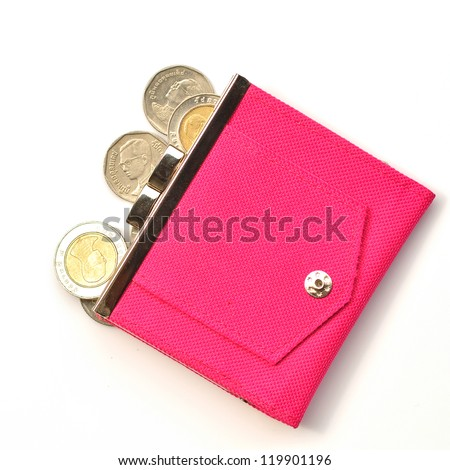 A pink leather purse with some coins in front of it.