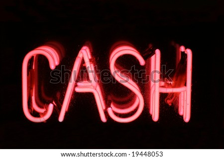 A Pink neon sign spelling out the words CASH. Set on a black background.