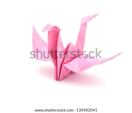 A pink origami bird isolated on white background