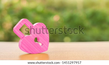 A pink padlock in shape of a heart. Heart health. The secret of relationships and the rules of a strong family. Strong love affair. Secrets, rumors and gossip. The concept of female intimate health. #1451297957