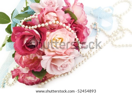 A pink rose bridal bouquet with blue ribbons and pearls on a horizontal white background with copy space
