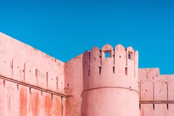 A pink tower from the entrance of Jaigarh Fort, the 3 km long fort offers a museum and views located in the north of Jaipur. Built to protect the Amber Fort complex below, Amer, Rajasthan, India