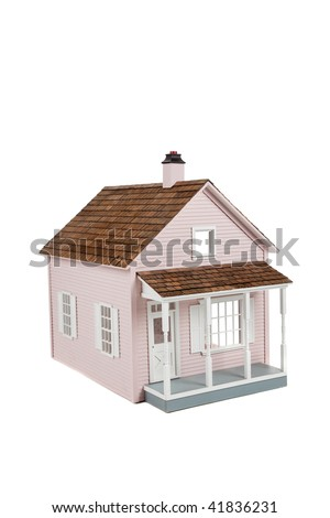 a Pink wooden dollhouse on a white background