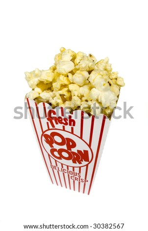 A piping hot container of movie popcorn isolated on white.