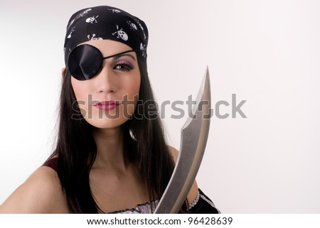 A pirate woman wearing eye patch holding with her knife blade