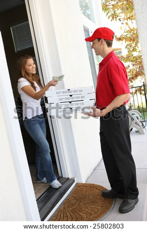 A  pizza delivery man giving order to pretty woman