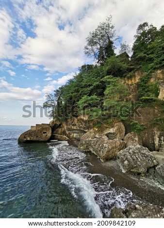 A place created for a holiday on the beach between the rocks in Trabzon Sürmene Çamburnu in the Black Sea. Stok fotoğraf ©