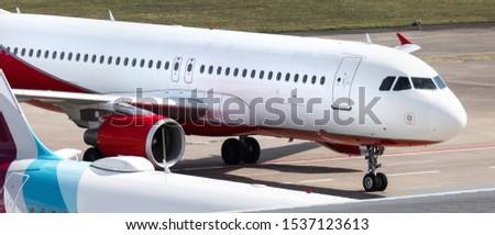 a plain passenger plain on the ground panorama #1537123613