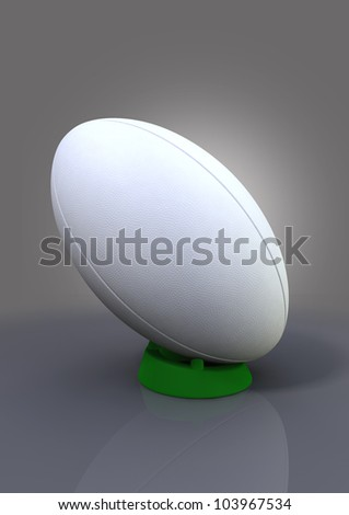 A plain white textured rugby ball on a blue kicking tee on a plain background