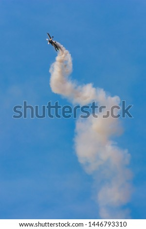 A Plane Executing an Ascent in Beautiful Curves During a Show #1446793310