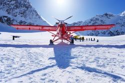 a plane landing on glacier in alaska