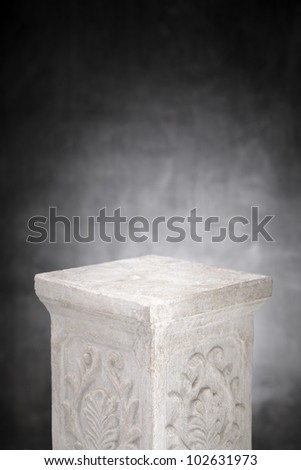 A Plaster column with nothing on its top.