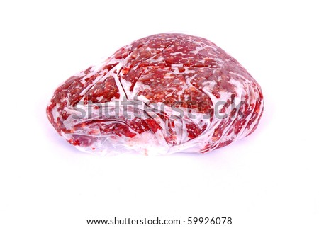 A plastic bag filled with frozen raw beef mince. Image isolated on white studio background.