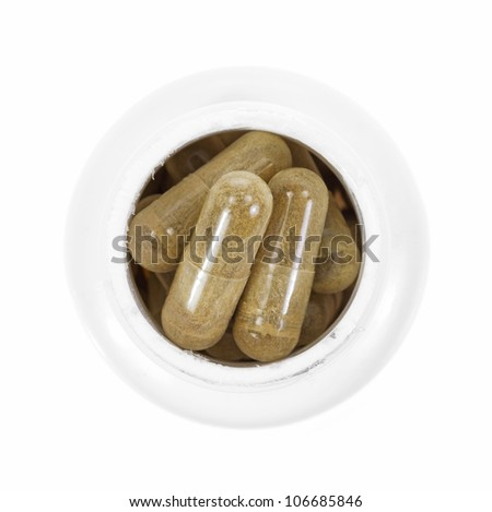 A plastic bottle filled with green tea extract capsules on a white background.