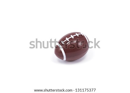 A plastic football sits amongst a white background with plenty of room for copy