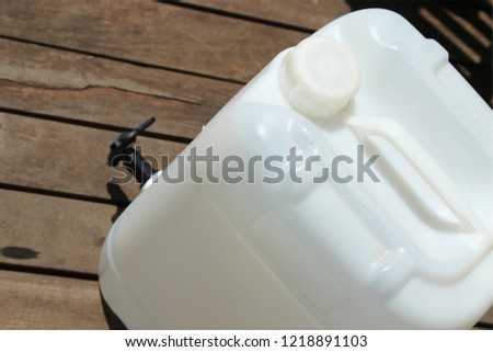 A plastic jerrycan with a tap. This image can be used to represent water conservation or water rationing.