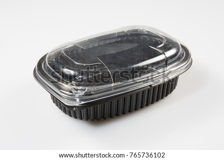 A plastic package with a black lid and a transparent lid #765736102