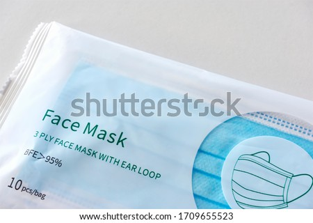 A plastic package with 3 ply disposable breathing face masks with ear loop.