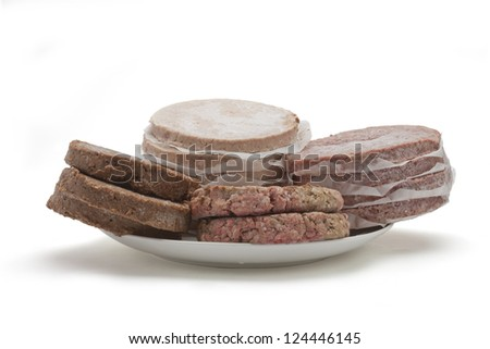 A plate filled with many meat patties