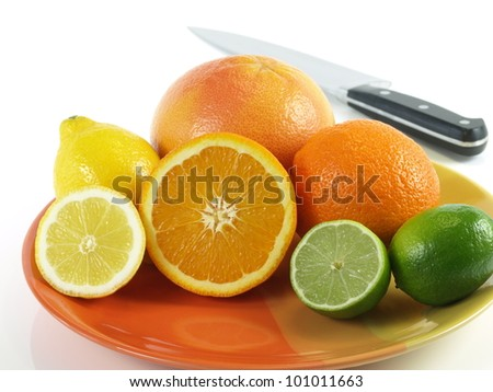 A plate full of healthy tropical fruits, studio isolated