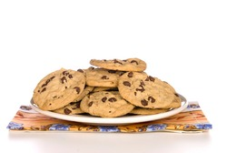 A plate of chocolate chip cookies with a white background.